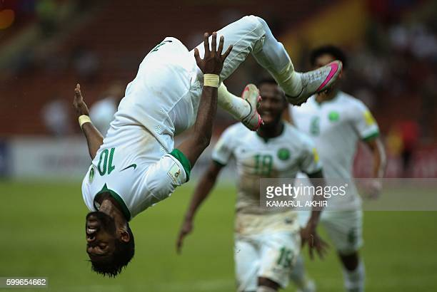Nawaf Alabid of Saudi Arabia celebrates a goal against Iraq during the 2018 World Cup qualifying football match between Iraq and Saudi Arabia at Shah...