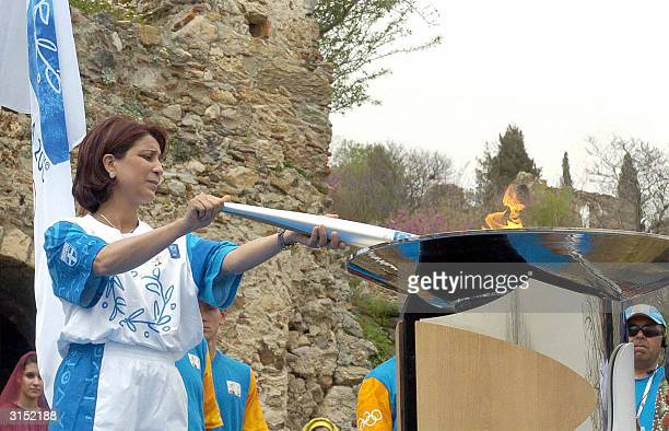 Nawal El Moutawakel from Maroco Olympic gold medalist in 400 meters hurdles at Los Angeles Games in 1984 uses the altar in Mistras near Sparta...