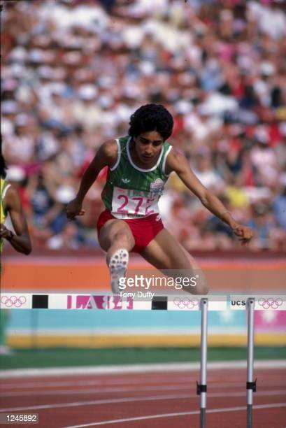 Nawal El Moutawakel of Morocco clears a hurdle in the women's 400m hurdle final en route to capturing the gold medal in the 1984 Summer Olympic Games...