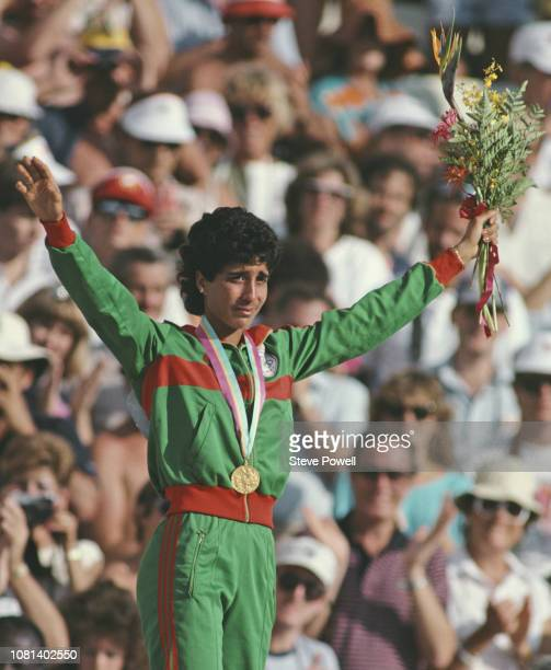 Nawal El Moutawakel of Morocco stands on the podium after receiving her gold medal for winning the inaugural Women's 400 metres hurdles event at the...