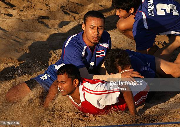 Nawal Raut of Nepal is tackled by Somboon Asa of Thailand during the Beach Kabaddi match bewteen Nepal and Thailand at North Al Hail during day five...