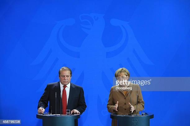 Nawaz Sharif Pakistan's prime minister left looks on as Angela Merkel Germany's chancellor speaks during a news conference at the Chancellery in...