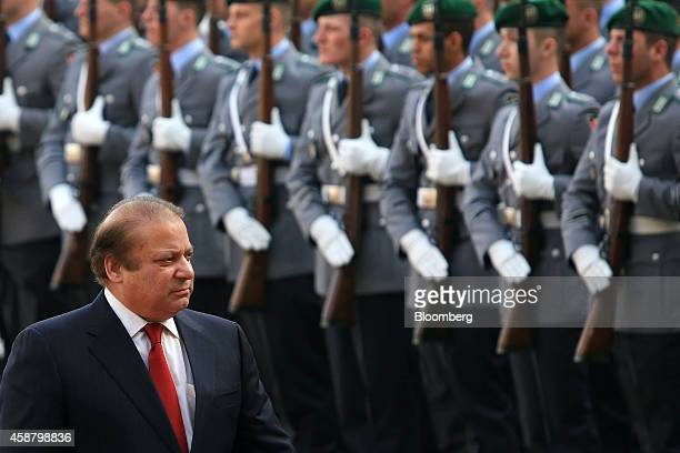 Nawaz Sharif Pakistan's prime minister reviews an honor guard ahead of a news conference at the Chancellery in Berlin Germany on Tuesday Nov 11 2014...