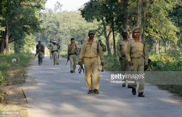 Naxals Menace in Dantewada District police officers patrolling the naxal infested forests at Bijapur near Dantewada