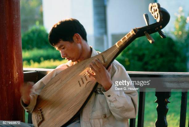Naxi Man Playing a Pipa