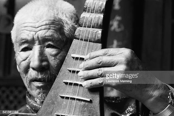 Naxi Mandolin Player
