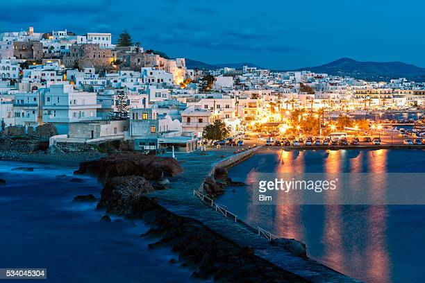 naxos illuminated at dusk, cyclades, greece - naxos stockfoto's en -beelden