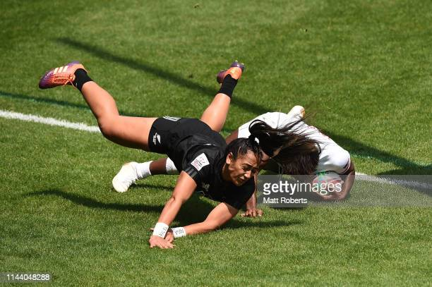 Naya Tapper of USA scores a try under pressure from Dhys Faleafaga of New Zealand during the cup quarter final match between USA and New Zealand on...