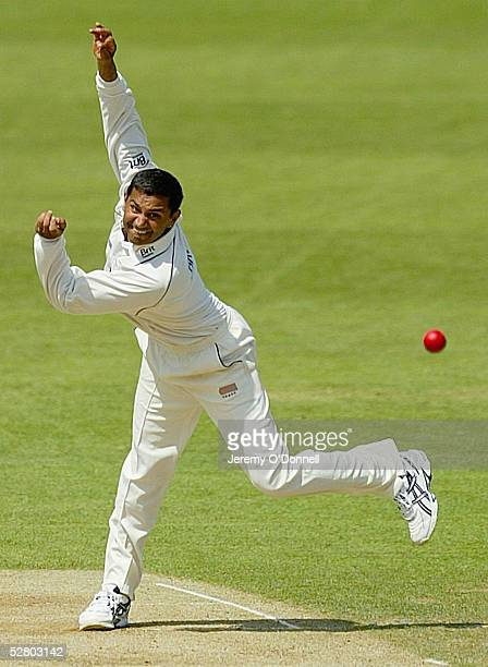 Nayan Doshi of Surrey bowls during day two of the Frizzell county championship match between Surrey and Glamorgan held at the Brit Oval on May 12,...