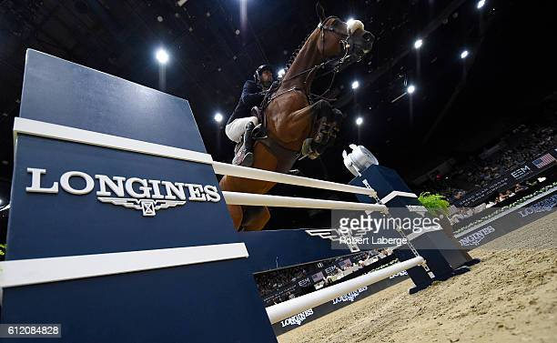 Nayel Nassar of Egypt during the Longines Grand Prix event at the Longines Masters of Los Angeles 2016 at the Long Beach Convention Center on October...