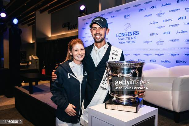 Nayel Nassar of Egypt winner of the Longines Grand Prix de New York with his girlfriend Jennifer Gates and the trophy at the Longines Masters New...