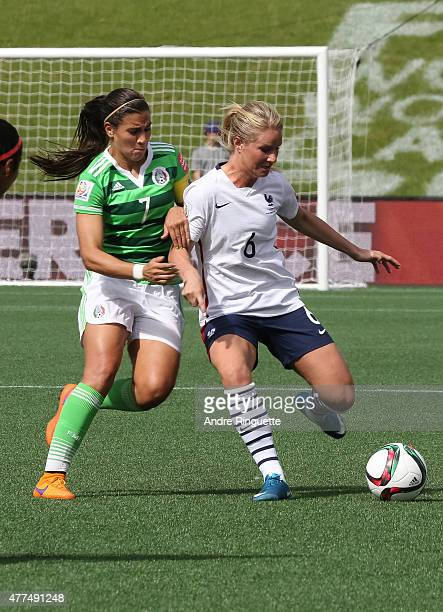 Nayeli Rangel of Mexico battles for the ball against Amandine Henry of France during the FIFA Women's World Cup Canada 2015 Group F match between...