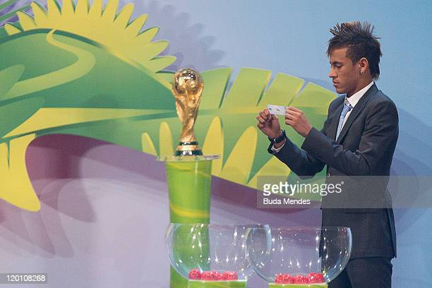 Naymar from Brazil picks a ball during the Preliminary Draw of the 2014 FIFA World Cup at the Marina da Gloria on July 29 2011 in Rio de Janeiro...