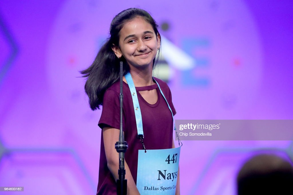 Naysa Modi smiles after correctly spelling the word 'telyn' during the final rounds of the 91st Scripps National Spelling Bee at the Gaylord National Resort and Convention Center May 31, 2018 in National Harbor, Maryland. Forty one finalists were selected to participate in the final day after a record 516 spellers were officially invited, up from 291 in 2017 .