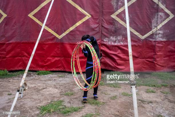 Nayusky a circus performer collects her hoops to practice her act at the Circo Hermanos Lopez in Quetzaltenango Guatemala