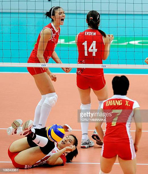 Naz Aydemir of Turkey reacts when her teammate Eda Erdem blocks a spike from Li Juan of China while China's Zhang Xian looks on during their first...