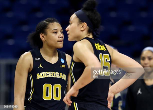 Naz Hillmon and Hailey Brown of the Michigan Wolverines react to the loss to the Baylor Lady Bears during the Sweet Sixteen round of the NCAA Women's...