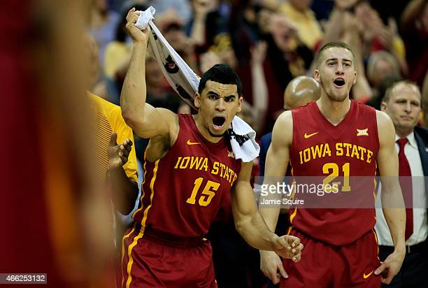 Naz Long and Matt Thomas of the Iowa State Cyclones react from the bench in the second half against the Kansas Jayhawks during the championship game...