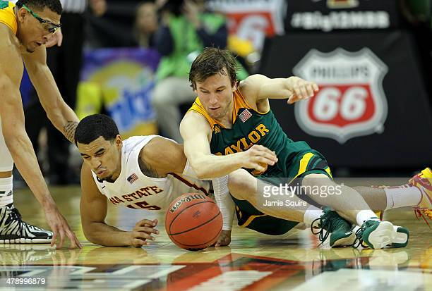 Naz Long of the Iowa State Cyclones and Brady Heslip of the Baylor Bears scramble for a loose ball during the Big 12 Basketball Tournament final game...