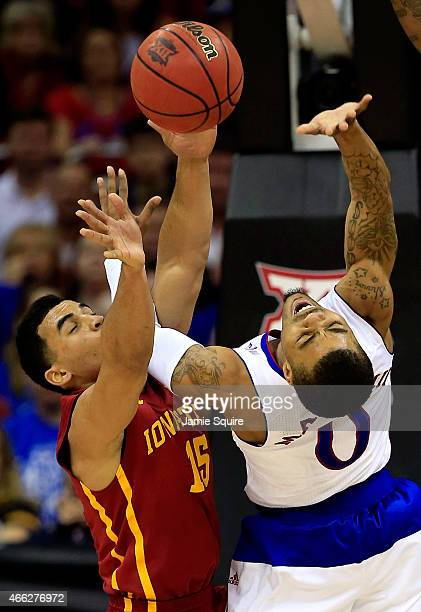Naz Long of the Iowa State Cyclones blocks a shot by Frank Mason III of the Kansas Jayhawks during the second half of the championship game of the...