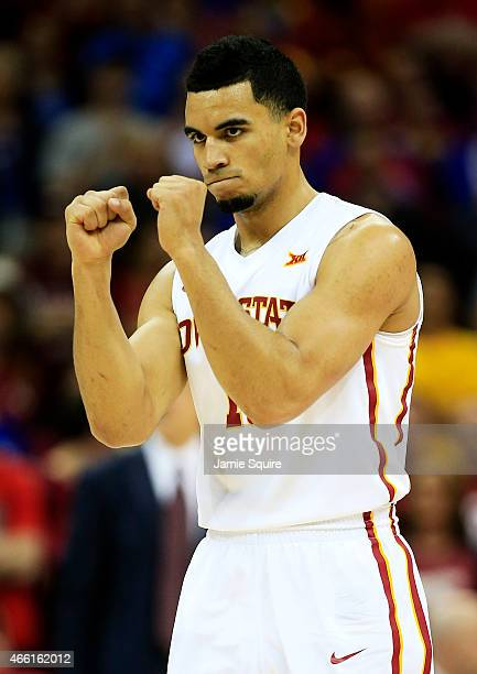 Naz Long of the Iowa State Cyclones celebrates after their 67 to 65 win over the Oklahoma Sooners during a semifinal game of the 2015 Big 12...
