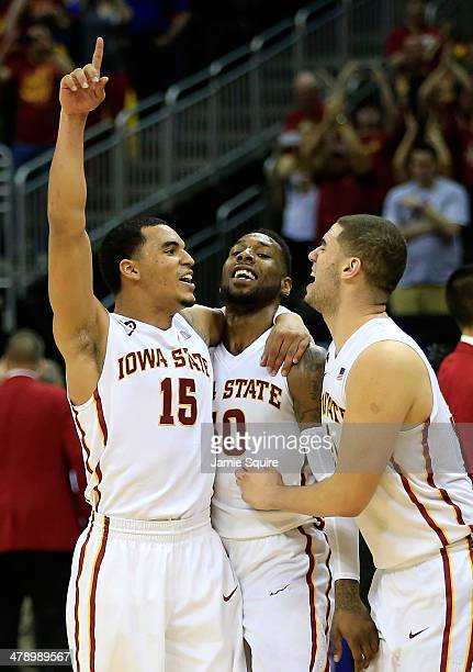 Naz Long of the Iowa State Cyclones celebrates with DeAndre Kane and Georges Niang as the Cyclones defeat the Baylor Bears to win the Big 12...