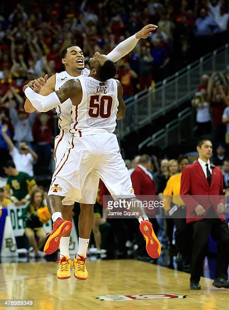 Naz Long of the Iowa State Cyclones celebrates with DeAndre Kane after the Cyclones defeated the Baylor Bears 7465 to win the Big 12 Basketball...