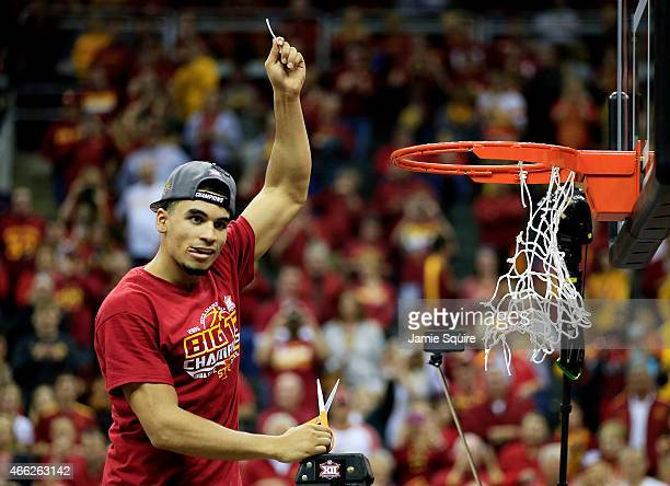 Naz Long of the Iowa State Cyclones cuts down a piece of the net after their 70 to 66 victory over the Kansas Jayhawks during the championship game...