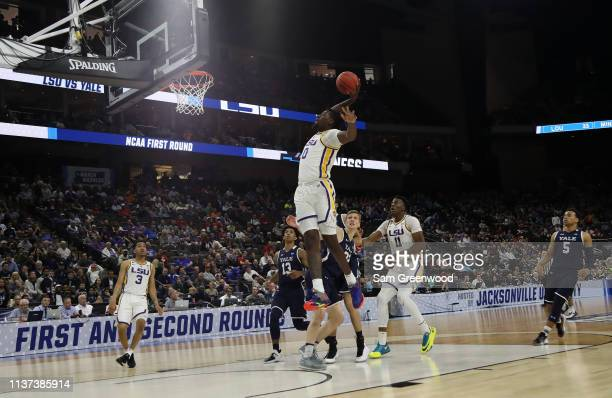 Naz Reid of the LSU Tigers goes in for a slam dunk in the first half against the Yale Bulldogs during the first round of the 2019 NCAA Men's...