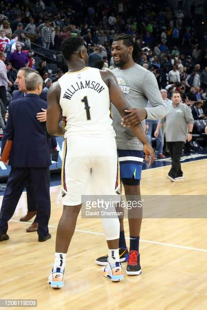 Naz Reid of the Minnesota Timberwolves talks with Zion Williamson of the New Orleans Pelicans after the game on March 8 2020 at Target Center in...