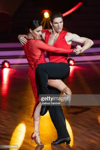 "Nazan Eckes and Christian Polanc perform on stage during the 11th show of the 12th season of the television competition ""Let's Dance"" on June 07,..."