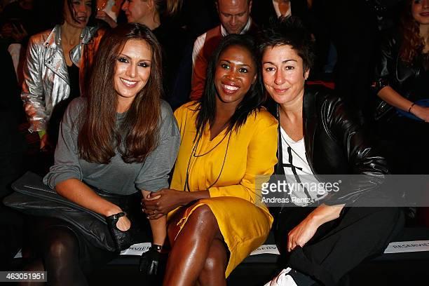 Nazan Eckes Motsi Mabuse and Dunja Hayali arrive for the Guido Maria Kretschmer Show during MercedesBenz Fashion Week Autumn/Winter 2014/15 at...