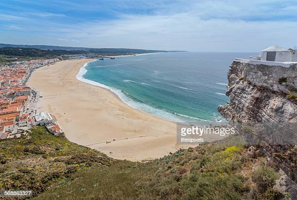 nazare beach, portugal - lifeispixels stock pictures, royalty-free photos & images
