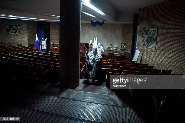 Nazarenes are prepared in assembly hall of the parish of Santa Gema in Santander before leaving in the evening procession of Prayer SANTANDER Spain...