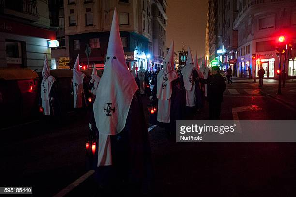Nazarenes of nocturnal procession of prayer cross the main streets of the city of Santander SANTANDER Spain on March 21 2016 Santander Easter this...