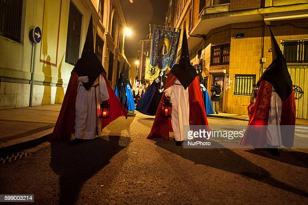 Nazarenes through the streets of Santander during nighttime procession of prayer celebrated on Easter Monday SANTANDER Spain on March 21 2016...