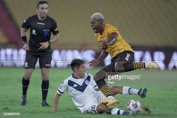 Nazareno Romero of Velez competes for the ball with Gabriel Cortez of Barcelona SC during a round of sixteen second leg match between Barcelona SC...