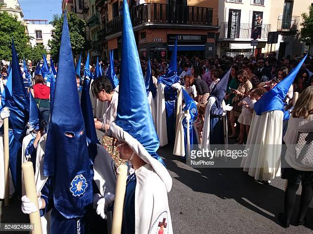 Nazarenos of the Brotherhood called quotLa Hiniestaquot during its parade to Cathedral on Sunday of Palms day called Domingo de Ramos in Spanish...