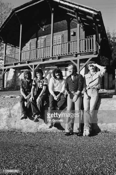 Nazareth British hard rock band pose outside a wooden chalet in Montreux Switzerland 1978