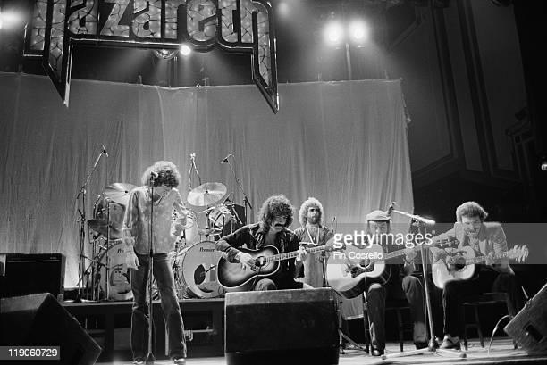 singer Dan McCafferty drummer Darrell Sweet guitarist Manny Charlton bassist Pete Agnew and guitarist Zal Cleminson British rock band on stage during...