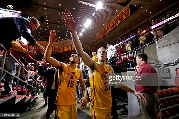 Nazareth MitrouLong and Matt Thomas of the Iowa State Cyclones celebrate with fans after defeating the Kansas State Wildcats 7065 at Hilton Coliseum...
