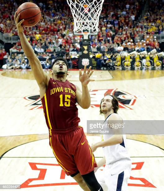 Nazareth Mitrou-Long of the Iowa State Cyclones scores as Nathan Adrian of the West Virginia Mountaineers looks on during the championship game of...