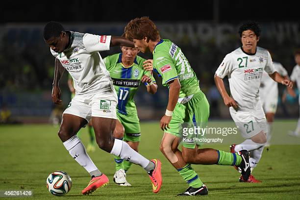 Nazarit of FC Gifu keeps the ball under the pressure from Tsuyoshi Shimamura of Shonan Bellmare during the J League second division match between FC...