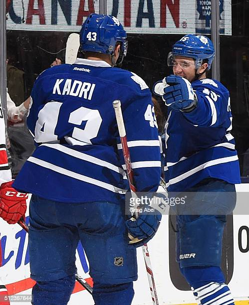 Nazem Kadri and PA Parenteau of the Toronto Maple Leafs celebrate a third period goal during NHL game action against the Carolina Hurricanes February...