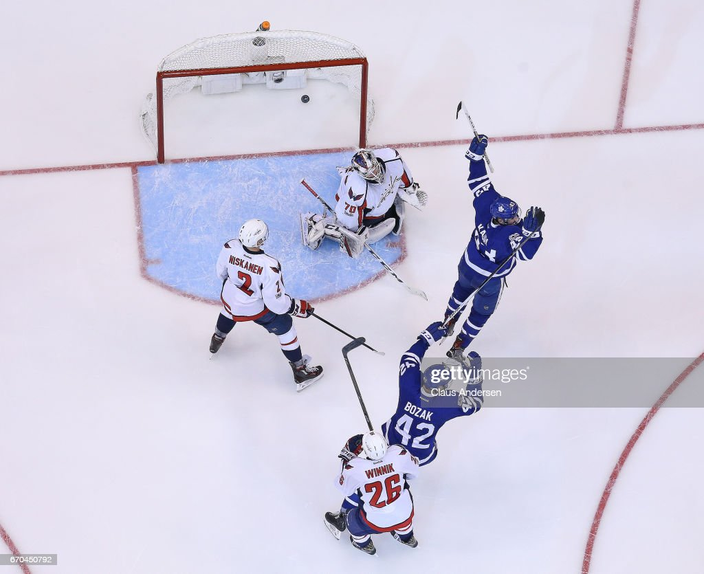 Nazem Kadri #43 and Tyler Bozak #42 of the Toronto Maple Leafs celebrate a goal by teammate James van Riemsdyk #25 (not shown) against the Washington Capitals in Game Four of the Eastern Conference Quarterfinals during the 2017 NHL Stanley Cup Playoffs at Air Canada Centre on April 19, 2017 in Toronto, Ontario, Canada. The Capitals defeated the Maple Leafs 5-4 to even series 2-2.