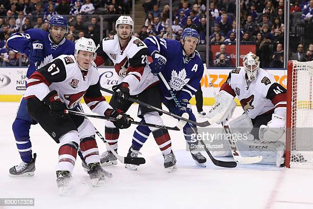 TORONTO ON DECEMBER 15 Nazem Kadri Lawson Crouse Oliver EkmanLarsson Leo Komarov and Mike Smith wait for the puck to come out of the corner as the...
