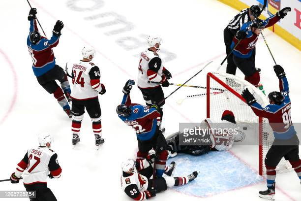 Nazem Kadri of the Colorado Avalanche celebrates with his teammates after scoring a goal on Darcy Kuemper of the Arizona Coyotes during the third...
