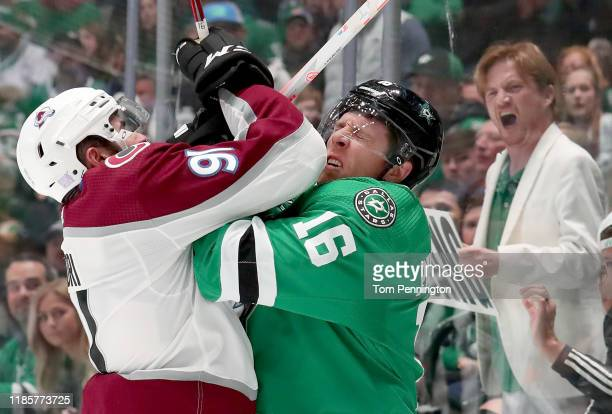 Nazem Kadri of the Colorado Avalanche checks Joe Pavelski of the Dallas Stars into the glass in the first period at American Airlines Center on...