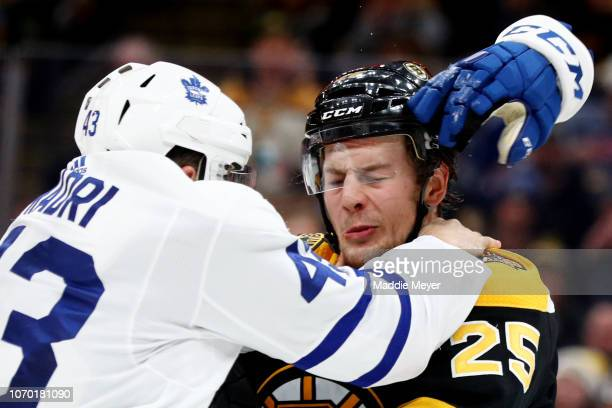 Nazem Kadri of the Toronto Maple Leafs and Brandon Carlo of the Boston Bruins fight during the second period of the game between the Boston Bruins...