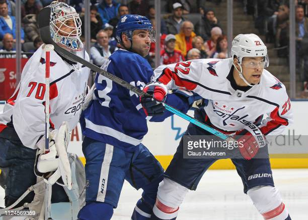 Nazem Kadri of the Toronto Maple Leafs battles between Braden Holtby and Madison Bowey of the Washington Capitals during an NHL game at Scotiabank...